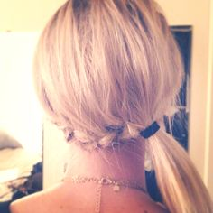 Low braid into a ponytail.