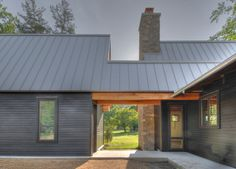 standing seam roof Exterior Transitional with concrete dog trot gravel metal…