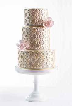 Brides.com: 34 Stunning Wedding Cakes for a Winter Wedding | Gold hand-painted metallic wedding cake by AK Cake Design