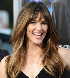 Adding soft bangs is a great way to make your whole face look younger! More celebrity hairstyles here: http://www.bhg.com/beauty-fashion/hair/hairstyles-for-women-over-40/?socsrc=bhgpin071714softbangs&page=8