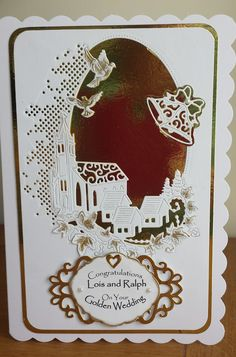 Made by Helen Aiken - Golden wedding card using the beautiful melded church die, together with Tattered Lace Bells die. Sentiment printed on computer and put on tab. Tiny flowers from Tattered Lace.