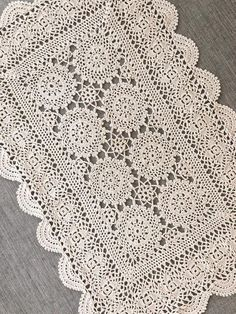 This rectangular vintage doily has been skillfully hand crocheted in ecru / beige cotton. It would make a stunning table decoration, a wedding table centerpiece, framed as a beautiful example of vintage lace, or even repurposed in creative ways.  This doily measures 27cm x 42cm / 10.5 x 16.5 and