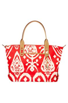 Red Ikat Tote Bag & Carryall Satchel | How Does She Do It Tote | Stella & Dot. Folds into a satchel handbag. Water bottle holder.
