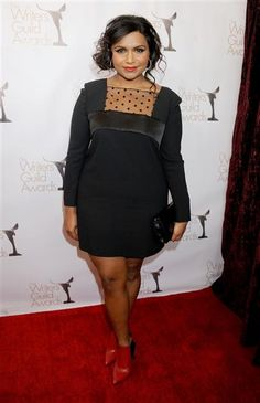 Mindy Kaling paired this black dress -- with its sweet, sheer neckline -- with red ankle boots for a chic-meets-downtown look at the Writers Guild Awards in Los Angeles on Jan. 17, 2013.RELATED: Duchess Kate, Mindy Kaling wear same L.K. Bennett dress
