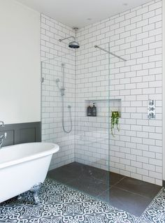 This gorgeous bathroom boasts a stunning freestanding bath, along with a combination of metro and patterned floor tiles. Bathroom Tile Designs, Bathroom Floor Tiles, Bathroom Design Small, Bathroom Interior Design, Metro Tiles Bathroom, Small Bathroom Plans, Tiny Bathrooms, Bathroom Wallpaper, Bathroom Ideas
