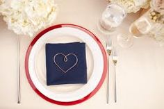 Elegant red, white and blue reception table setting