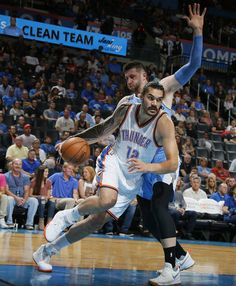 Oklahoma City's Steven Adams (12) goes past Denver's Jusuf Nurkic (23) during an NBA preseason basketball game between the Oklahoma City Thunder and the Denver Nuggets at Chesapeake Energy Arena in Oklahoma City, Tuesday, Oct. 18, 2016. Photo by Bryan Terry, The Oklahoman