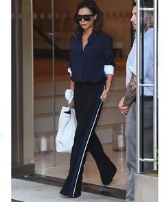 The thin side stripe makes her legs look longer, and matching them with accents on her top brings the outfit together.