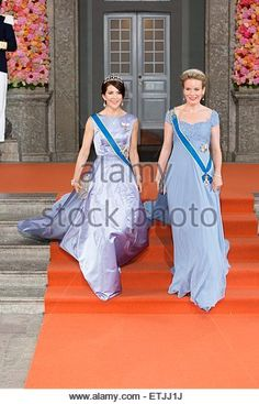 Stockholm, Sweden. 13th June, 2015. Queen Mathilde (R) of Belgium and Crown Princess Mary of Denmark leave the chapel of the Royal Palace after the wedding of Prince Carl Philip and Sofia Hellqvist in Stockholm, Sweden, 13 June 2015. © dpa picture alliance/Alamy Live News - Stock Image