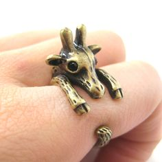 Details Sizing An adorable animal ring made in the shape of a baby giraffe wrapped around your finger in brass! Available in US size 7 to size our collection of giraffe rings and giraffe themed animal jewelry and products just visit our store! Animal Rings, Animal Jewelry, Giraffe Jewelry, Giraffe Ring, Giraffe Decor, Bronze Jewelry, Pet Gifts, Cute Jewelry, Jewelry Shop