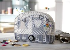 Caravan Pin Cushion - This is quite a large pin cushion so is a perfect place for pins, needles and safety pins. Pop a weight such as a pebble in the base and you have a cute book end or door stop! I've put most of the decoration just on one side, but you could easily add bunting all the way round, extra windows and plant pots filled with flowers! Available as a download here: http://www.debbieshore.tv/product/caravan-pin-cushion-pattern-and-instructions-download/