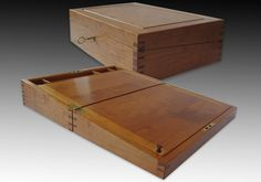 A writing box made from cherry.  The box measures sixteen inches by ten inches by four inches.  The image shows the box closed and open.  The writing slope opens to access storage compartments.