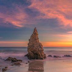 From my Rock Of Solitude series pointy rock #sunset. . . . . . . . .  #sunset_ig #longexposure_shots #seascapes .  #catchclick_all #ig_color #ig_today#sunrise_and_sunsets  #losangeles #losangelesgrammers#malibulife #uglagrammers  #wanderingphotographer  #nature_brilliance  #savethewaves  #earthpix  #westcoast_exposures  #splendid_nature  #ig_great_pics  #visualambassadors  #ig_masterpiece  #conquer_la  #instagram  #sunrise_sunset_photogroup  #socal  #travelgram #nikonnofilter #abc7la #nikkor…