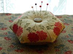 Fussy cut Hexagon pincushion, stuffed with sawdust.  Double Chocolat fabric