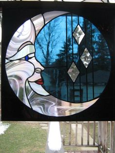 Stained glass moon with sky and stars surrounding her
