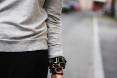 slightly oversized sweater, rolled sleeves, big bracelets