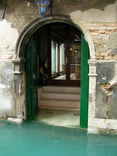 I wouldn't mind having to leave home every day in a gondola, not to mention those kelly green doors, glass doors, and brick --- Venice