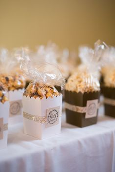Wedding favor ideas + inspiration to help you ditch the favors guests will toss and give them something unique that they'll want to keep! Cute favor ideas, sustainable wedding favors, food favors, DIY wedding favors and other favors that guests will love! Popcorn Wedding Favors, Italian Wedding Favors, Coffee Wedding Favors, Summer Wedding Favors, Popcorn Favors, Honey Wedding Favors, Creative Wedding Favors, Inexpensive Wedding Favors, Elegant Wedding Favors