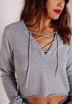 Super effortless, this lace up tie sweater in grey is the perfect addition to your wardrobe. Easy to wear and super versatile, it'll be your new go to piece. In a cropped length and long sleeve finish, this beaut is at the top of our wish l...