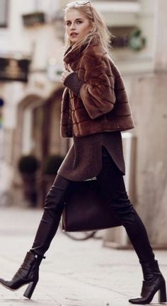 Caroline Daur is a vision in brown, rocking a pair of tight leather leggings, an oversized knit sweater, and a cute cropped faux fur jacket. Finish the look off with a pair of heeled ankle boots to recreate this look. Via Just The Design.  Jacket: Hallhuber, Pullover: Bogner, Shoes: Zara, Sunglasses: Jimmy Choo, Bag - Aigner. #caroline