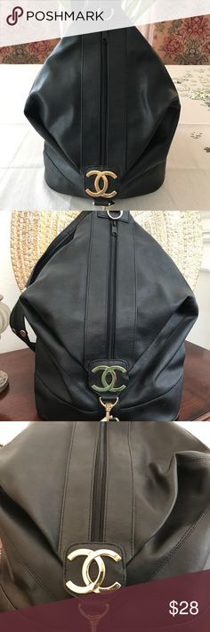 Chanel Backpack Chanel Vintage Look Backpack. Can be made into two straps or one cross strap. Gently used. Look at details. Hardware is a bit discolored but overall in good condition. Price reflects authenticity. Bags Backpacks