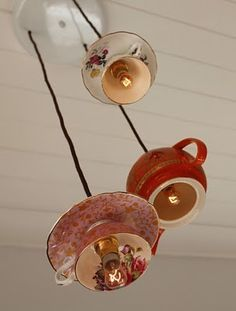 For a unique twist on a delicate and charming sunroom theme, decorate your lamps with vintage teacups and saucers hanging from the ceiling. Fun DIY project that can be customized to match any existing sunroom decor! #vintage #diy