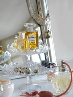 Vintage and Glass cake plates, beautiful way to display perfume and pretties on your dresser...