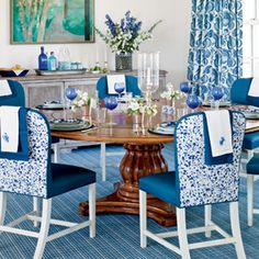100 Comfy Cottage Rooms | Plenty of Prints - dark wood table anchors a classic coastal blue & white palette, dash added by a credenza w/ the weathered texture of driftwood & print-covered white-legged chairs from Hickory Chair  | CoastalLiving.com