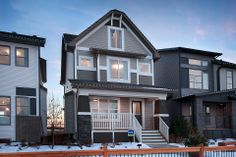The veranda is a beautiful touch to this gorgeous house design.  Excel Homes- Ellison show home, Copperfield, Calgary