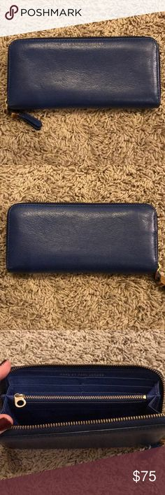 Marc by Marc Jacobs zip wallet Marc by Marc Jacobs zip wallet. 8 credit card slots. 2 full size slots (for cash). Change pocket with zipper. Space on either side of credit card slots for misc (ie gift cards).  Cobalt blue with gold hardware. Marc By Marc Jacobs Bags Wallets
