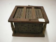 From the Chatham Historical Society archives: Antique foot warmer or foot oven. Wood frame, tin inserts with wire handle.  #atwoodhouse, #museum, #chatham, #footwarmer, #foot, #warmer, #antique, #chathamhistoricalsociety, #capecod