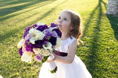 flower girl holding bride bouquet, JayLee Photography