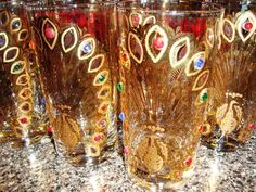 Close up of Culver jeweled Peacock glasses.  I have a cocktail set which includes a martini pitcher and six glasses. The cocktail set is older than the glasses shon here but these glasses sill bear the script Culver signature.