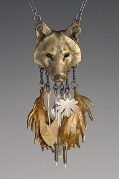 Bronze Alpha Wolf w/ Moose Antlers and Water Plant Charms.  .