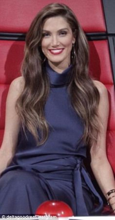 Crossing to the dark side: On Sunday night's episode of The Voice Australia, Delta Goodrem sported darker brown tresses (L), a change from her usual golden locks (R)