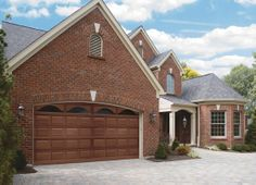 @Clopay Doors | Residential Garage Doors and Entry Doors | Commercial Doors Classic Wood Collection Short Raised Panel Garage Doors with Long Cathedral Glass