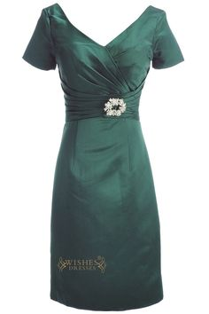 This classic A-line gown features a v neckline with short length sleeves, a ruched surplice drop waist bodice and a brooch embellishment. Skirt length can be changed to tea-length or Floor-length. Nec