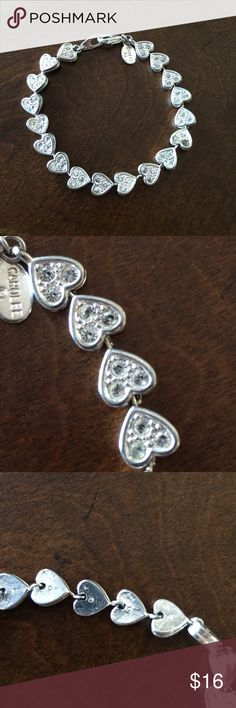 Carolee Crystal heart bracelet. Carolee Crystal heart bracelet. This bracelet is clean and ready to be worn. It has all its Crystal stones accented in polished chrome. **One stone is dark. As a fashion bracelet at a price like this you won't be sorry. Happy hunting. Carolee Accessories