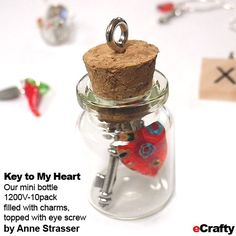 "DIY Key to My Heart from eCrafty.com: Anne made these little treasures with our 1200V 1"" bottles, 1611B Key Charms, and a little millefiori glass bead red heart on our 1505Z. She trimmed the key charm END to fit the length of the inner bottle.  #messagebottle #bottlecharm #minibottle #glassbottle #glassbottlecharm #memory #charm #diy #crafts #beads #beading #diycrafts #wedding #heart #key #ecrafty"