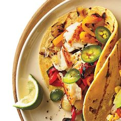 Sautéed tilapia tacos with grilled peppers & onion / cookinglight.com