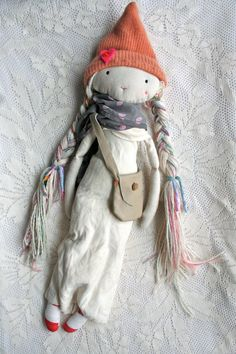 I looooove this girl. She is made with lots of love - her hair is a beautiful wool/linen mix with all natural pastel rainbow highlights of
