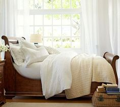A classic sleigh bed is always a lovely choice.  I like the layered ivory linens in this picture as well.  Jefferson Sleigh Bed Pottery Barn