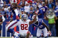 New York Giants vs Buffalo Bills: Full highlights and recap  -    Oct 4, 2015; Orchard Park, NY, USA; New York Giants wide receiver Rueben Randle (82) celebrates his touchdown as Buffalo Bills cornerback Stephon Gilmore (24) and strong safety Bacarri Rambo (30) look on during the first half at Ralph Wilson Stadium. Mandatory Credit: Kevin Hoffman-USA TODAY Sports