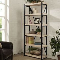the denver bookcase thick stock shelves inset into metal rails with an x back that accents the design and improves rigidity
