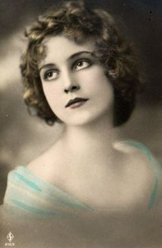A beautiful face   vintage hand tinted photo
