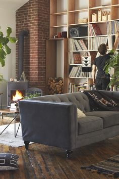 LOVE this modern couch mixed with the homie surroundings. Super cute and hip!