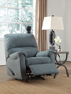 With clean and simple lines, the Zeth rocker recliner is at home with many different styles of decor. The comfortably firm seat cushion and back provide the optimal level of support. Thanks to an easy pull tab mechanism, transforming the Zeth from chair to recliner is practically effortless.