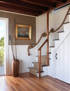Looped rope handrail, white wainscoting, gilt frame
