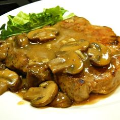 Pork Chops in Garlic Mushroom Sauce Recipe Simmering boneless pork chops in a garlicky mushroom sauce is a great dinner idea for Valentine's Day. Garlic Mushroom Sauce, Garlic Mushrooms, Stuffed Mushrooms, Stuffed Peppers, Mushroom Recipe, Mushroom Gravy, Garlic Sauce, Seared Pork Chops, Boneless Pork Chops