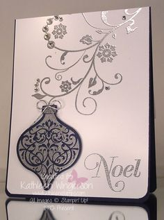 Stampin' Up! Ornament Keepsakes, Flowering Flourishes and Greetings; Whisper White and Night of Navy card stocks; Silver Metallic Encore pad; Big Shot Holiday Ornament Framelits dies; Silver embossing powder; Rhinestones